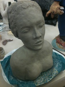 Wet Clay Sculpture.  My first failure in the kiln.  She lost a boob and a cheek in the process.